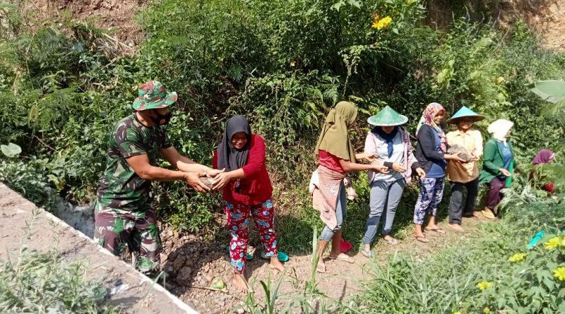 Cuaca Tak Bersahabat,Satgas TMMD, Tetap Semangat Membangun Desa